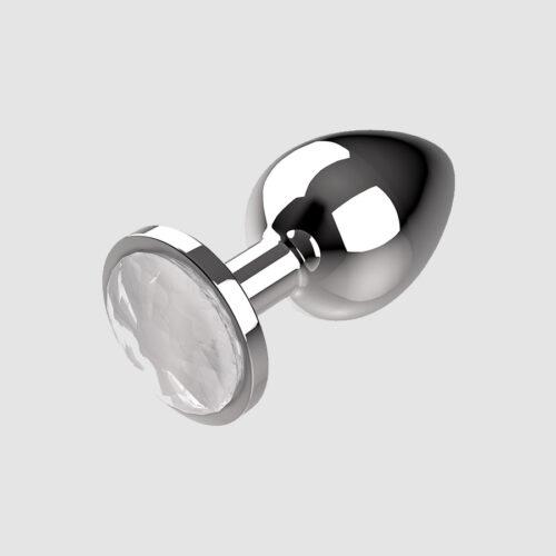 Valge kristalliga metallist anaaltapp Coquette. Saadaval kolme suurusena (S, M ja L). Kaasas ka hoiustamiskott ning alus kaunistatud valge kristalliga.